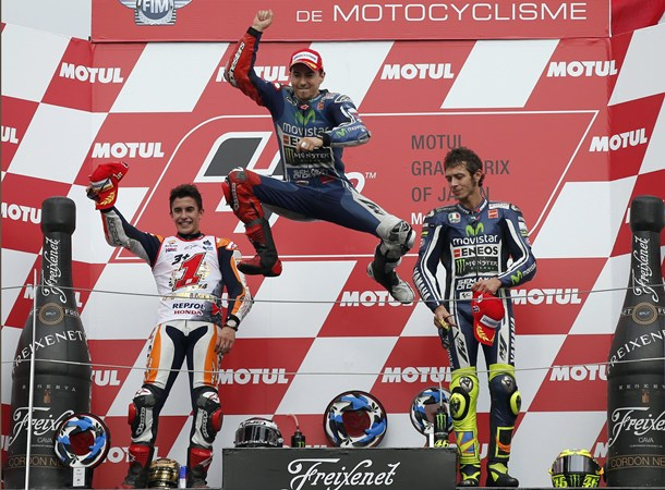 Lorenzo jumps into the air as he celebrates winning the Japanese Grand Prix at the Twin Ring Motegi circuit